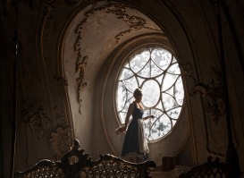 Belle (Emma Watson) in the ballroom of the Beast's castle in Disney's BEAUTY AND THE BEAST, a live action adaptation of the studio's animated classic directed by Bill Condon which brings the story and characters audiences know and love to life.