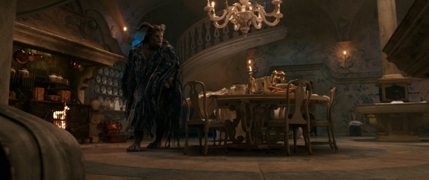 The Beast (Dan Stevens) with Lumiere the candelabra and Cogsworth the mantel clock in the castle kitchen in Disney's BEAUTY AND THE BEAST, a live action adaptation of the studio's animated classic which is a celebration of one of the most beloved stories ever told.