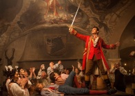 Gaston (Luke Evans) a handsome but arrogant brute, holds court in the village tavern in Disney's BEAUTY AND THE BEAST, directed by Bill Condon, a live action adaptation of the studio's animated classic and a celebration of one of the most beloved stories ever told.
