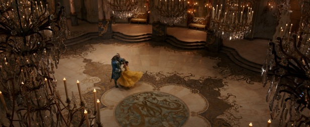 Belle (Emma Watson) comes to realize that underneath the hideous exterior of the Beast (Dan Stevens) there is the kind heart of a Prince in Disney's BEAUTY AND THE BEAST, a live action adaptation of the studio's animated classic directed by Bill Condon.